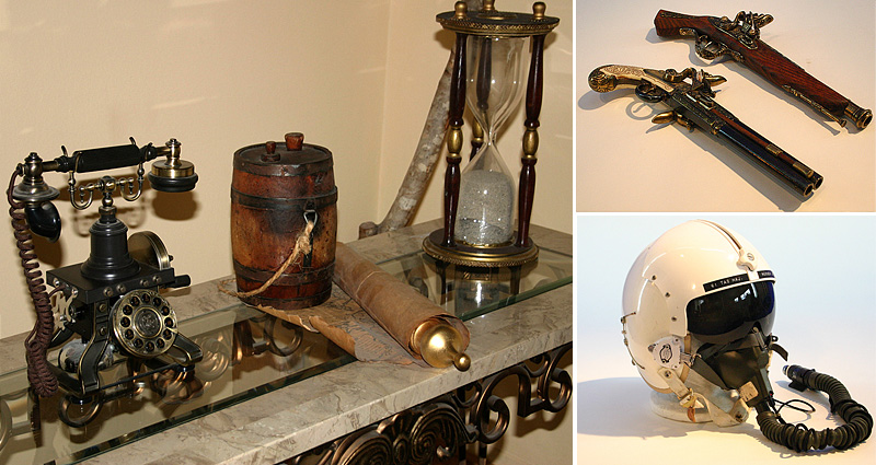 period props, flight helmet, buccaneer pistols, hourglass, pirate props, turn of the century Eiffel Tower telephone